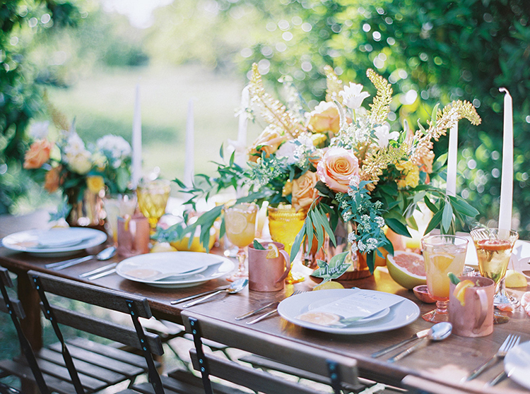 wedding tablescapes - photo by Melissa Jill Photography https://ruffledblog.com/citrus-and-copper-orchard-wedding-inspiration