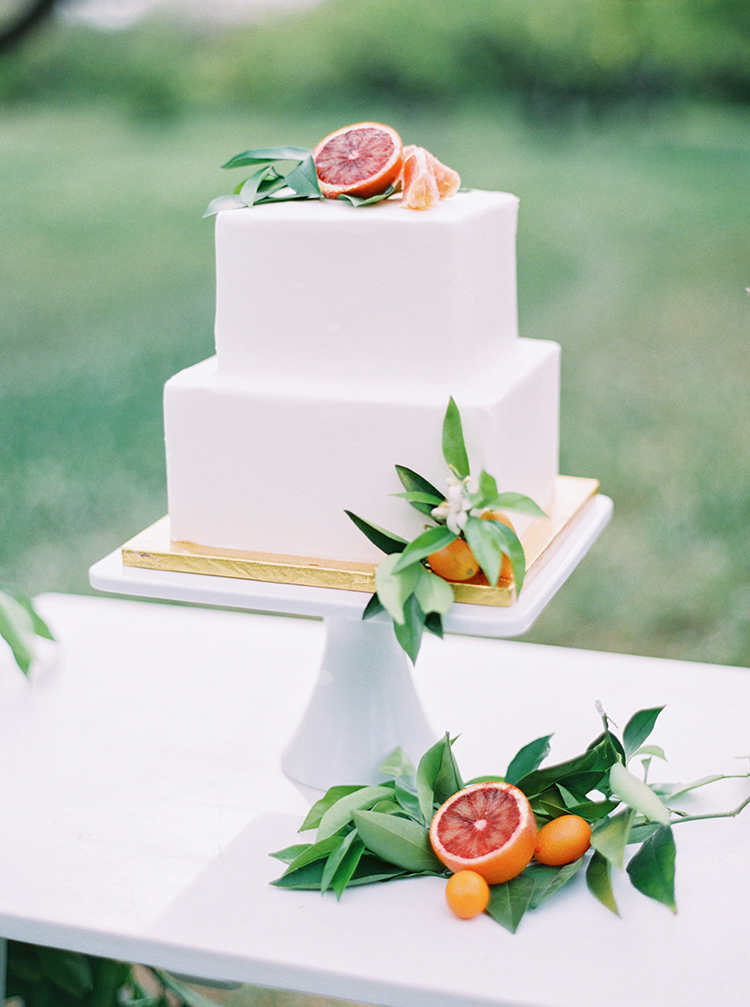 citrus topped wedding cakes - photo by Melissa Jill Photography https://ruffledblog.com/citrus-and-copper-orchard-wedding-inspiration