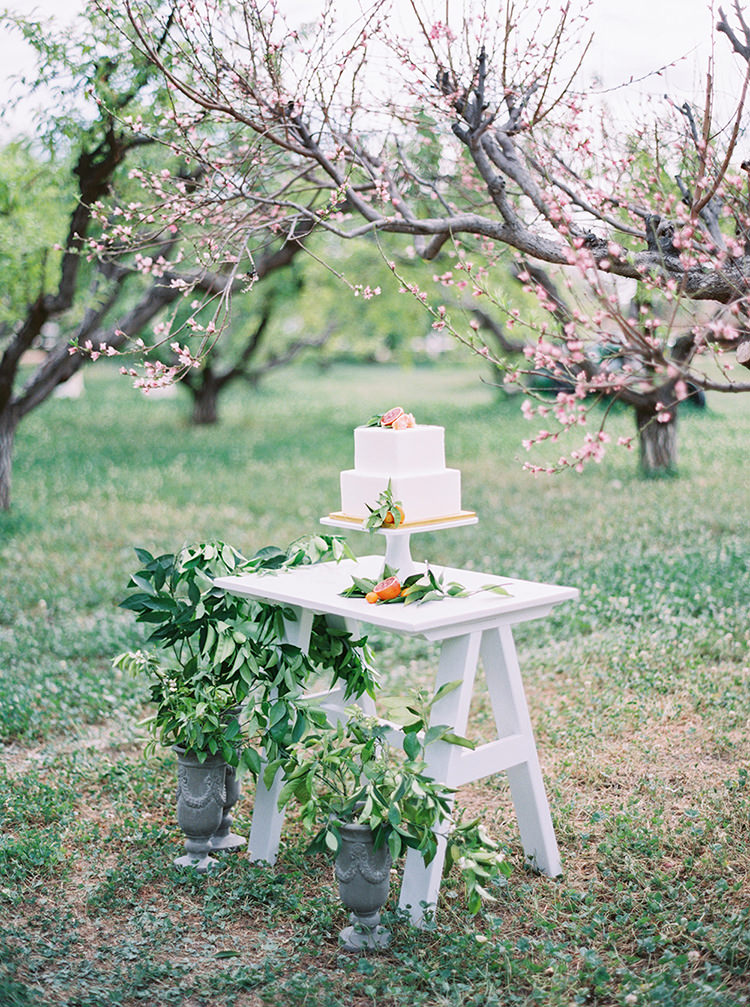 outdoor wedding tables - photo by Melissa Jill Photography https://ruffledblog.com/citrus-and-copper-orchard-wedding-inspiration