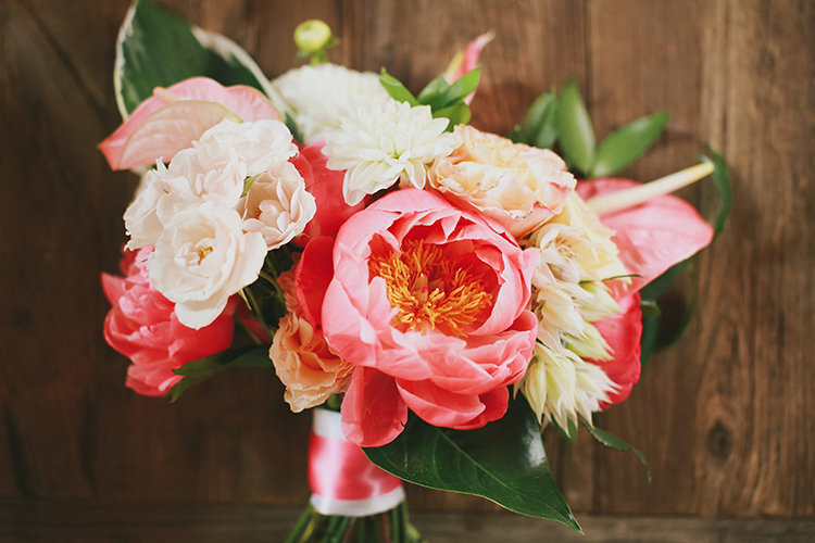 coral charm peony wedding bouquet - photo by Kassia Phoy https://ruffledblog.com/citrus-hued-whimsical-wedding-with-paper-details