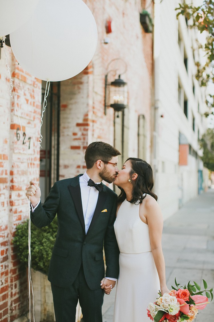 wedding portraits with balloons - photo by Kassia Phoy https://ruffledblog.com/citrus-hued-whimsical-wedding-with-paper-details