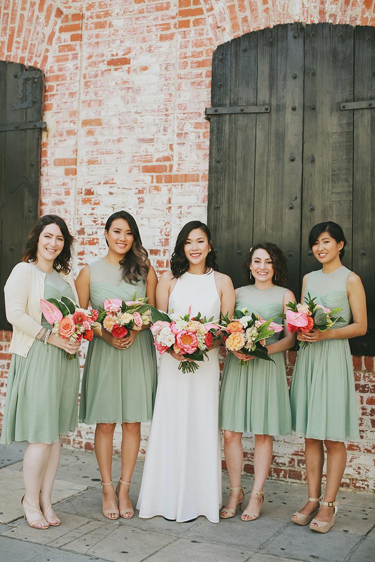 seafoam green bridesmaid dresses - photo by Kassia Phoy https://ruffledblog.com/citrus-hued-whimsical-wedding-with-paper-details