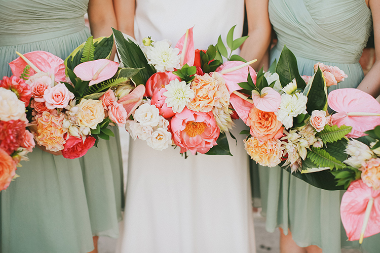 modern tropical inspired bouquets - photo by Kassia Phoy https://ruffledblog.com/citrus-hued-whimsical-wedding-with-paper-details