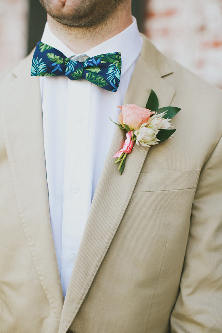 tan wedding suits - photo by Kassia Phoy https://ruffledblog.com/citrus-hued-whimsical-wedding-with-paper-details