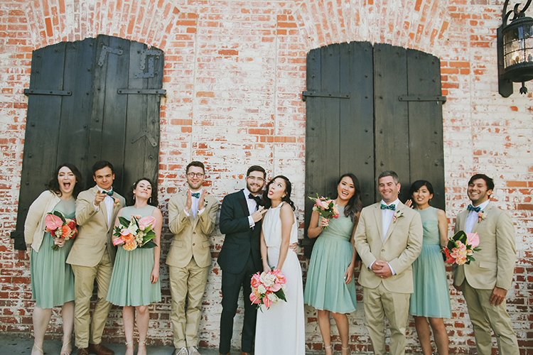 wedding party portraits - photo by Kassia Phoy https://ruffledblog.com/citrus-hued-whimsical-wedding-with-paper-details