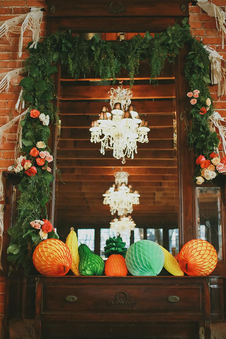 whimiscal ceremony decor - photo by Kassia Phoy https://ruffledblog.com/citrus-hued-whimsical-wedding-with-paper-details