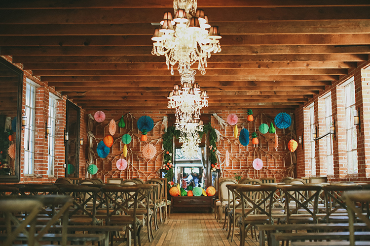whimsical wedding ceremonies - photo by Kassia Phoy https://ruffledblog.com/citrus-hued-whimsical-wedding-with-paper-details
