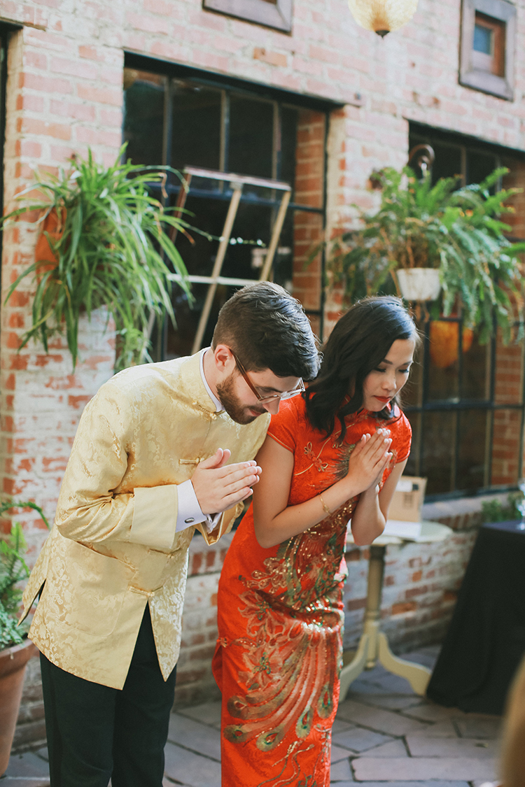 Chinese tea ceremonies - photo by Kassia Phoy https://ruffledblog.com/citrus-hued-whimsical-wedding-with-paper-details