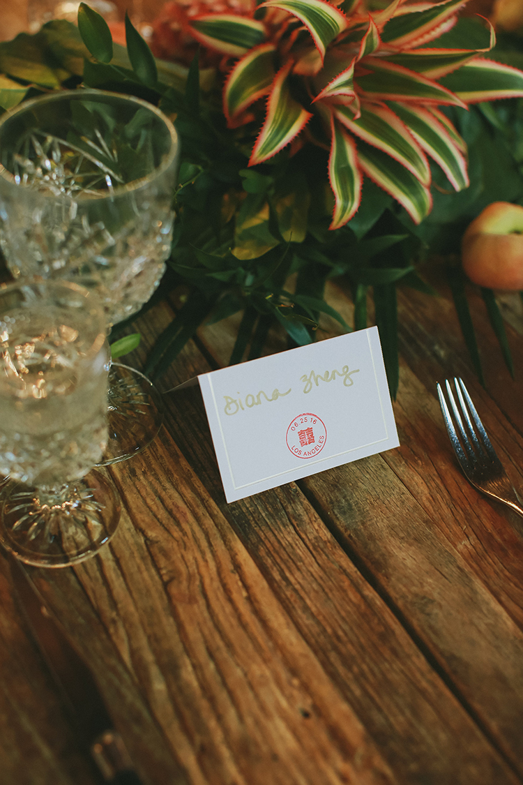 wedding name cards - photo by Kassia Phoy https://ruffledblog.com/citrus-hued-whimsical-wedding-with-paper-details