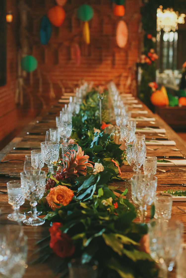 green and orange wedding centerpieces - photo by Kassia Phoy https://ruffledblog.com/citrus-hued-whimsical-wedding-with-paper-details