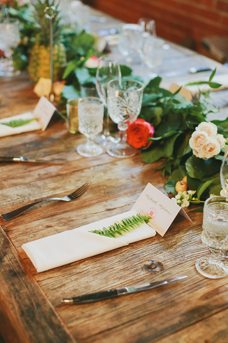 wedding with greenery - photo by Kassia Phoy https://ruffledblog.com/citrus-hued-whimsical-wedding-with-paper-details