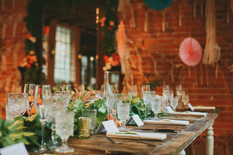 wedding tablescapes - photo by Kassia Phoy https://ruffledblog.com/citrus-hued-whimsical-wedding-with-paper-details