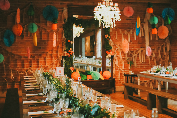whimsical wedding receptions - photo by Kassia Phoy https://ruffledblog.com/citrus-hued-whimsical-wedding-with-paper-details