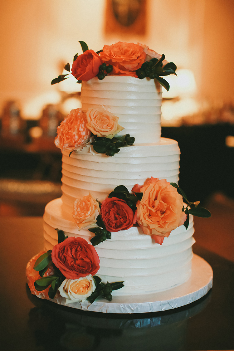 ivory wedding cakes with flowers - photo by Kassia Phoy https://ruffledblog.com/citrus-hued-whimsical-wedding-with-paper-details