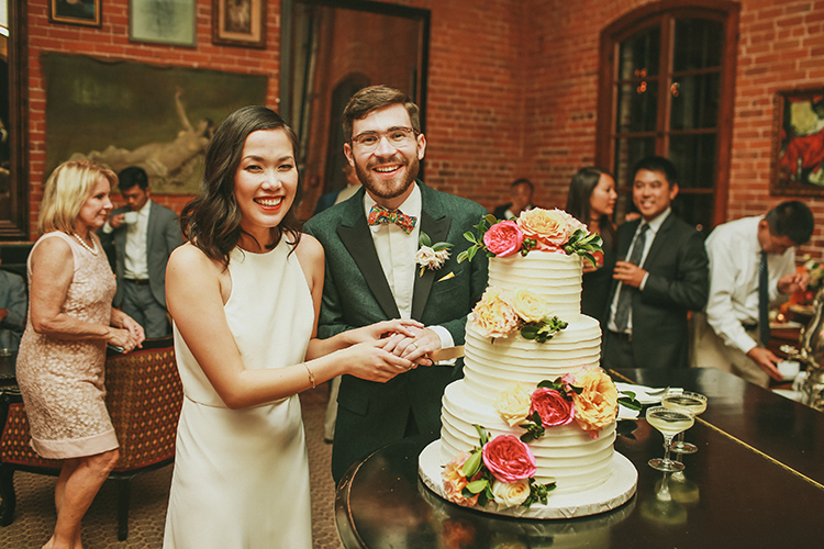 cake cutting - photo by Kassia Phoy https://ruffledblog.com/citrus-hued-whimsical-wedding-with-paper-details