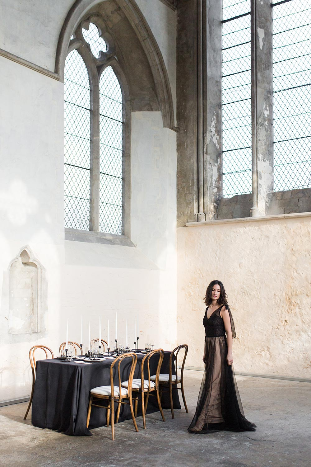 modern black tablescape in classical stonewashed venue