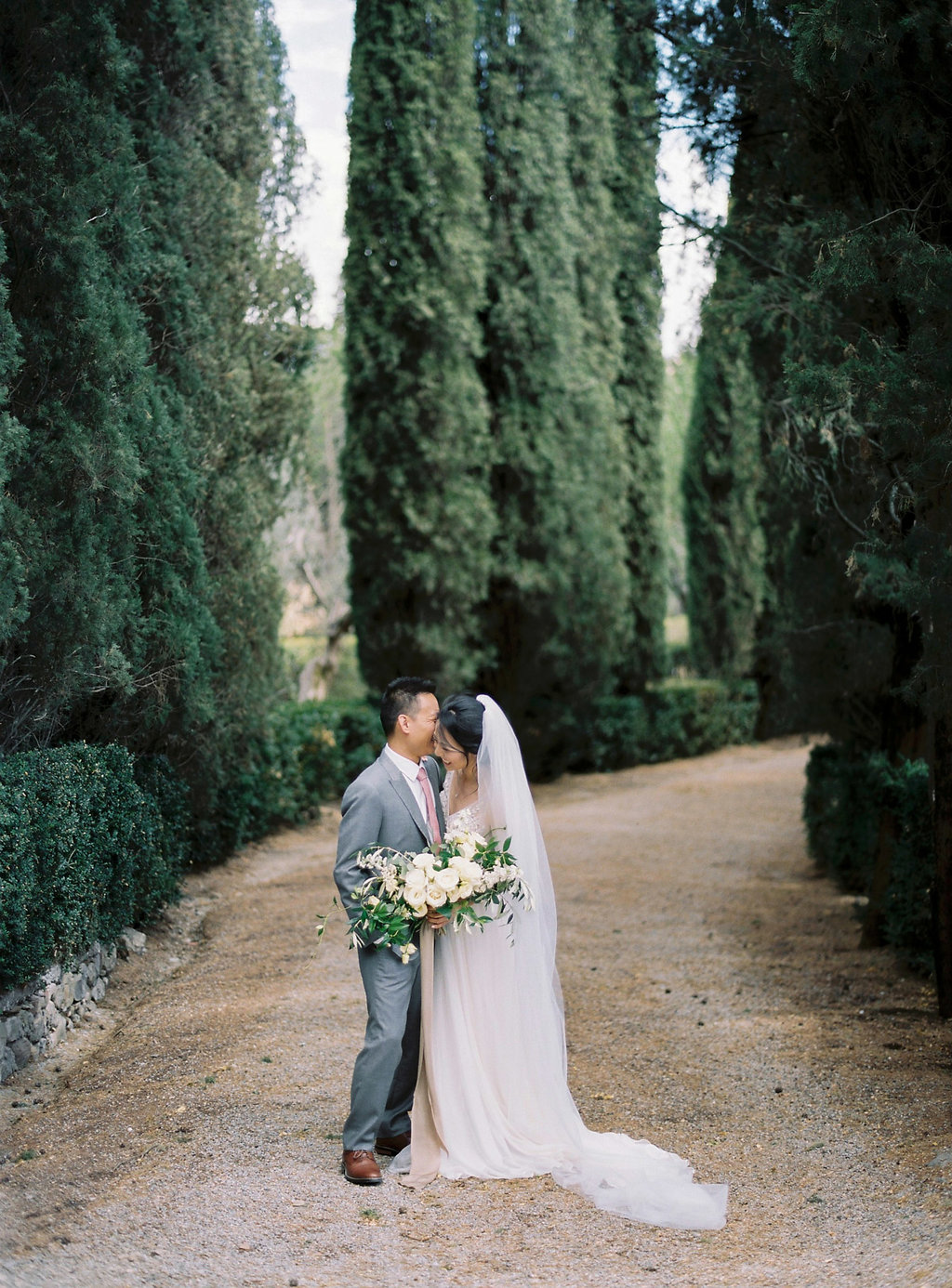 Tuscan wedding portraits - photo by Katie Grant Photography https://ruffledblog.com/classically-beautiful-intimate-wedding-in-tuscany