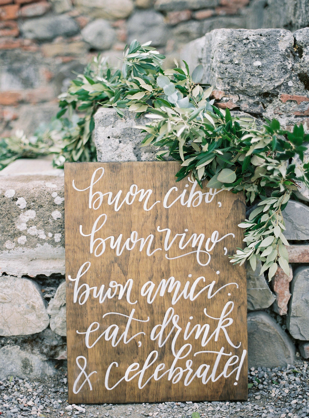 Italian wooden wedding signs - photo by Katie Grant Photography https://ruffledblog.com/classically-beautiful-intimate-wedding-in-tuscany