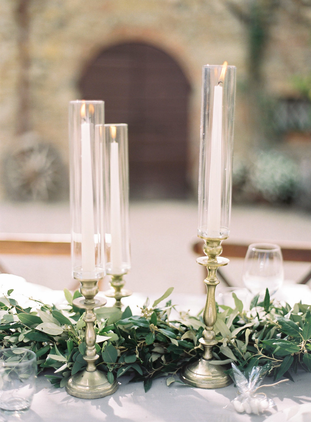 candlestick centerpieces - photo by Katie Grant Photography https://ruffledblog.com/classically-beautiful-intimate-wedding-in-tuscany