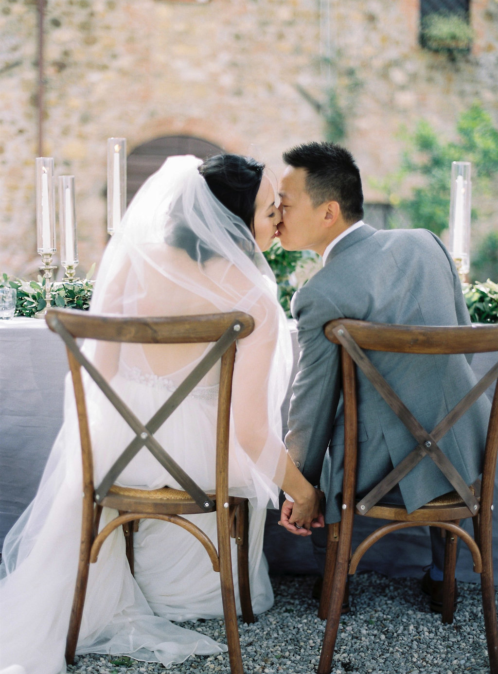 sweetheart table kisses - photo by Katie Grant Photography https://ruffledblog.com/classically-beautiful-intimate-wedding-in-tuscany