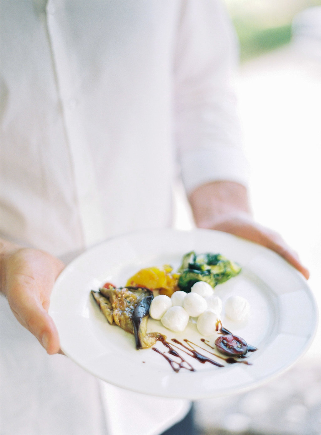gourmet wedding catering - photo by Katie Grant Photography https://ruffledblog.com/classically-beautiful-intimate-wedding-in-tuscany