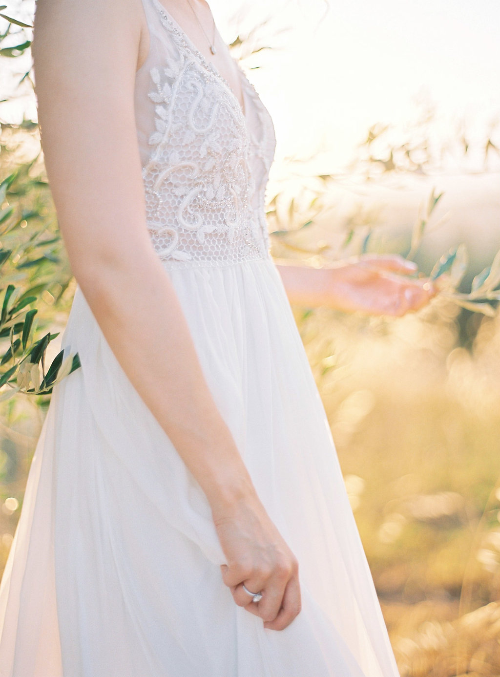 lace wedding dress details - photo by Katie Grant Photography https://ruffledblog.com/classically-beautiful-intimate-wedding-in-tuscany