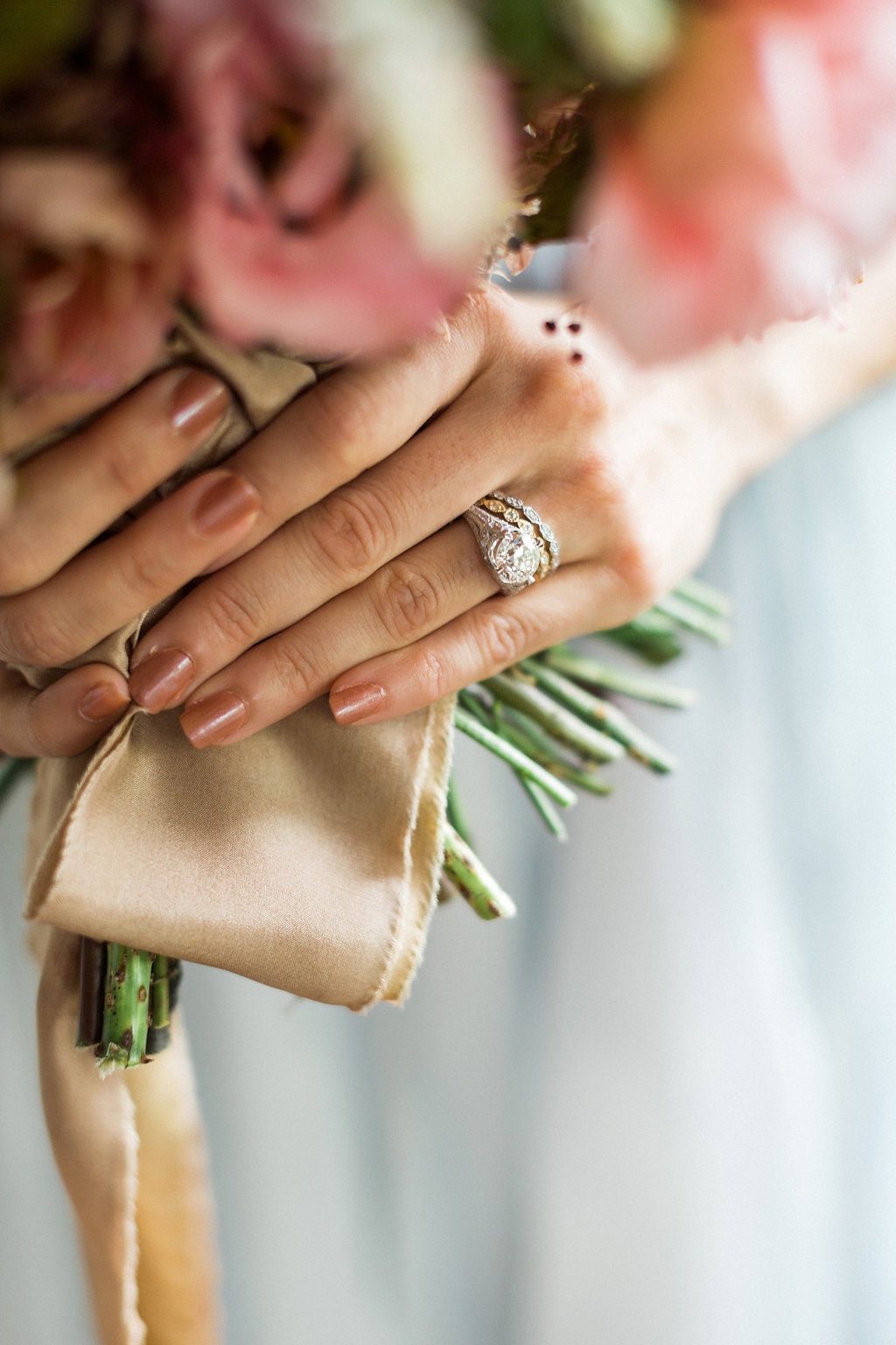 vintage inspired wedding engagement rings - https://ruffledblog.com/cloudy-day-wedding-inspiration-with-a-hand-painted-bridal-gown