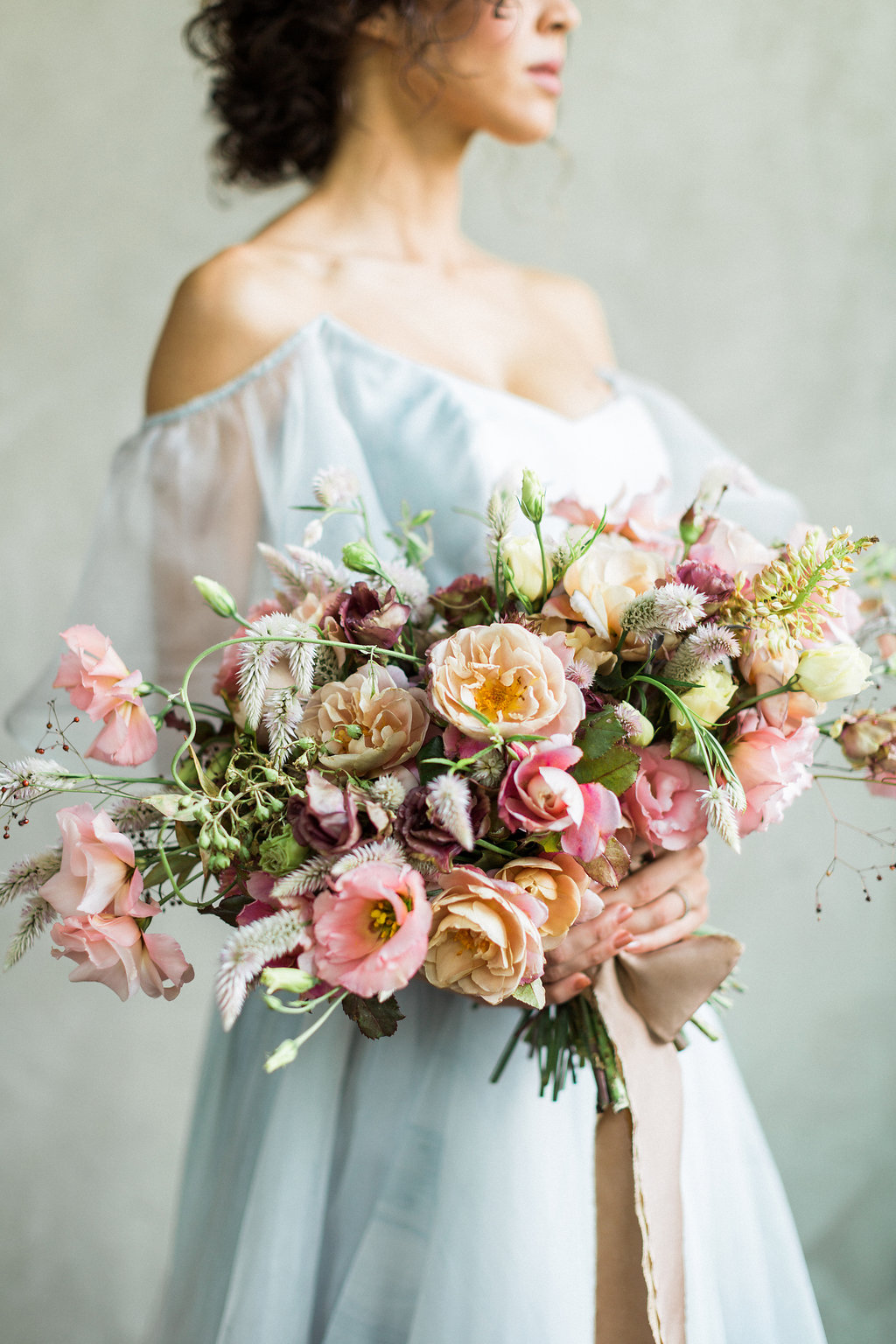 soft and romantic fine art wedding bouquets - https://ruffledblog.com/cloudy-day-wedding-inspiration-with-a-hand-painted-bridal-gown
