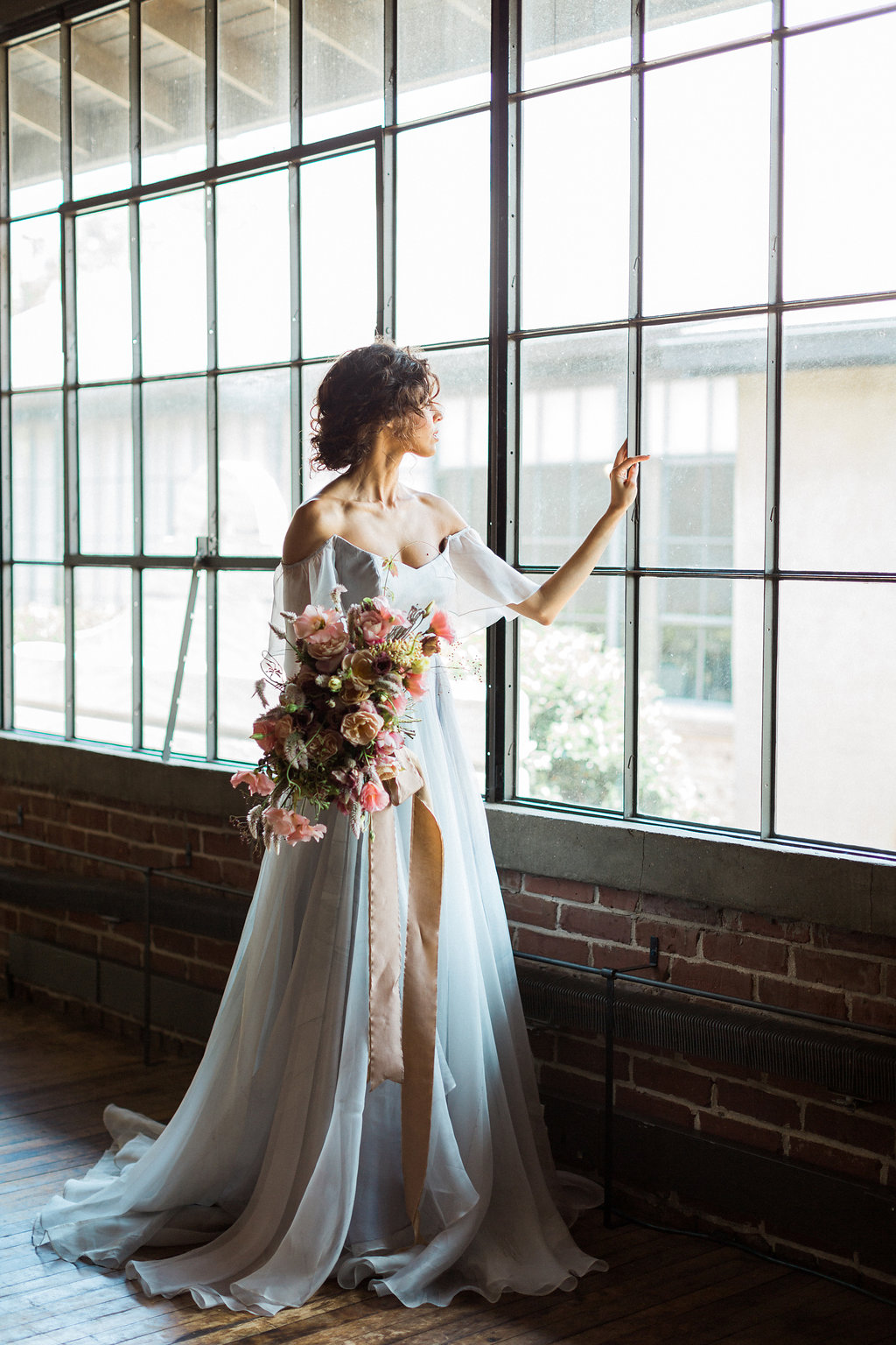 romantic industrial wedding inspiration - https://ruffledblog.com/cloudy-day-wedding-inspiration-with-a-hand-painted-bridal-gown