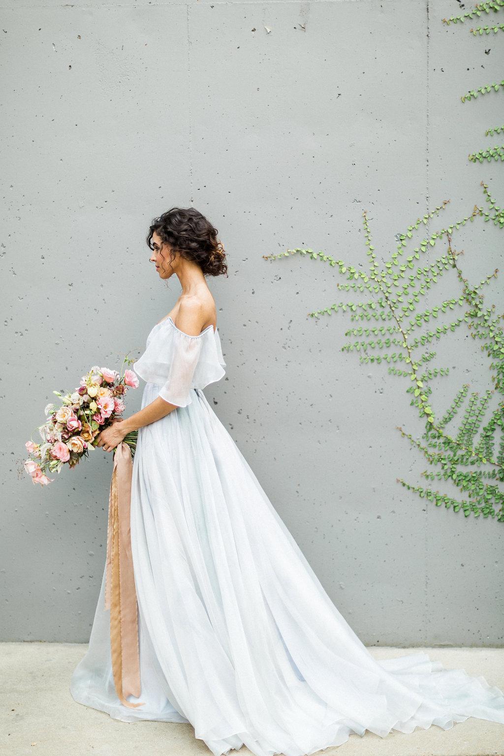 romantic bridal inspiration with a blue wedding dress - https://ruffledblog.com/cloudy-day-wedding-inspiration-with-a-hand-painted-bridal-gown