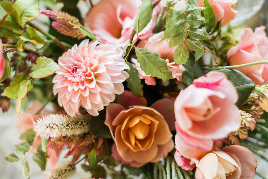 pink and orange wedding flowers - https://ruffledblog.com/cloudy-day-wedding-inspiration-with-a-hand-painted-bridal-gown