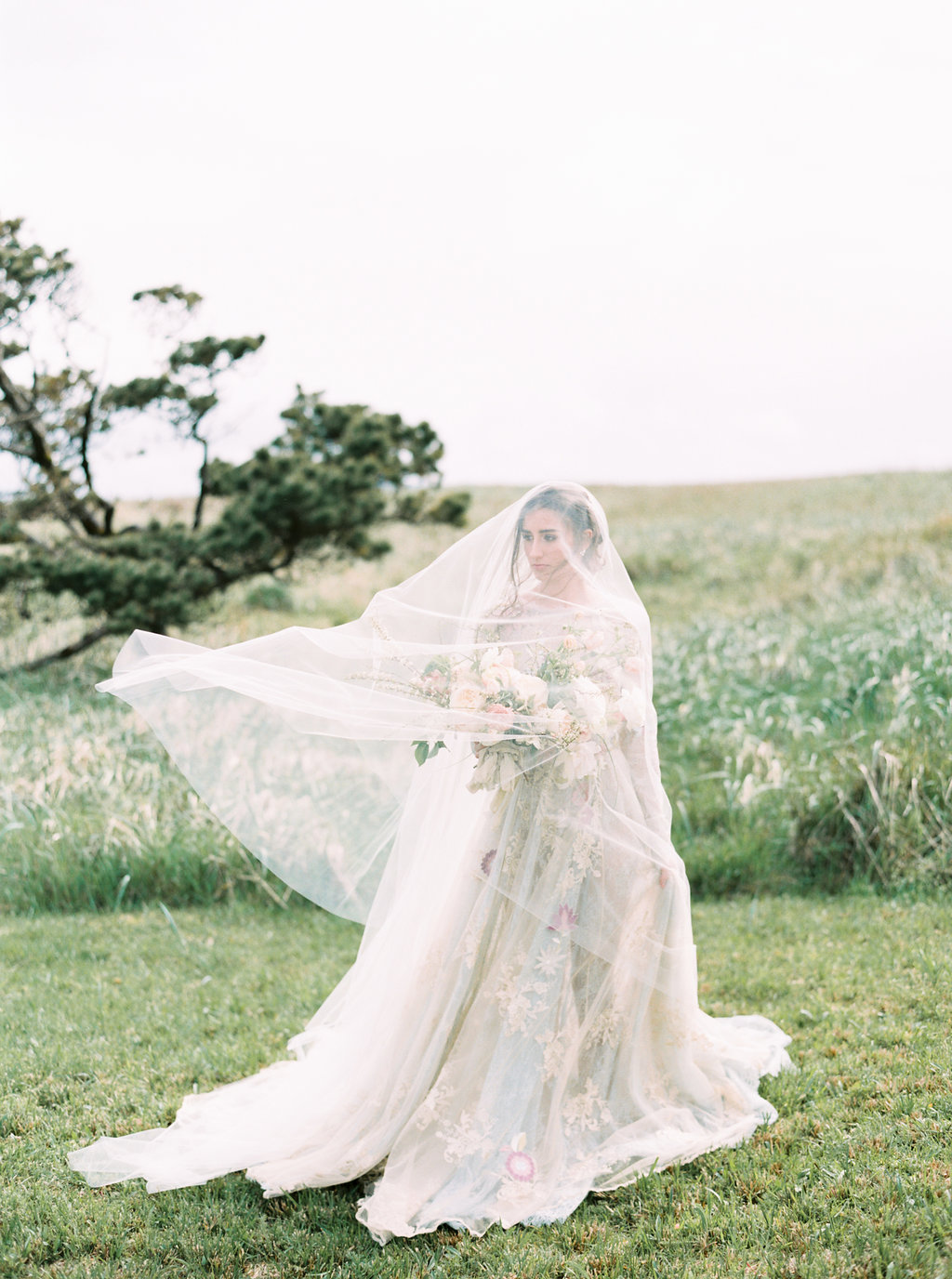 Coastal Oregon Inspiration with a Show-Stopping Wedding Gown - photo by Be Light Photography http://ruffledblog.com/coastal-oregon-inspiration-with-a-show-stopping-wedding-gown