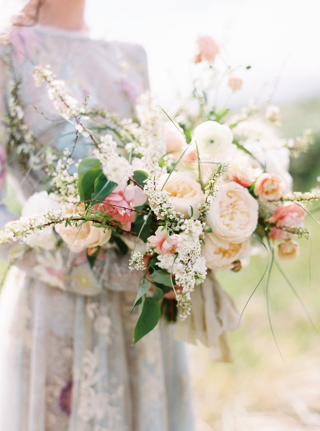 romantic bouquets - photo by Be Light Photography http://ruffledblog.com/coastal-oregon-inspiration-with-a-show-stopping-wedding-gown