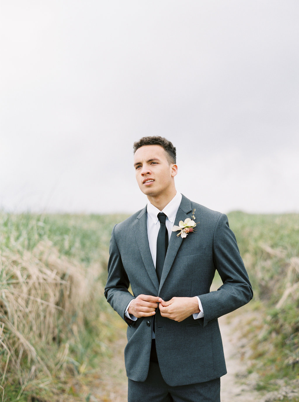 groom style - photo by Be Light Photography http://ruffledblog.com/coastal-oregon-inspiration-with-a-show-stopping-wedding-gown