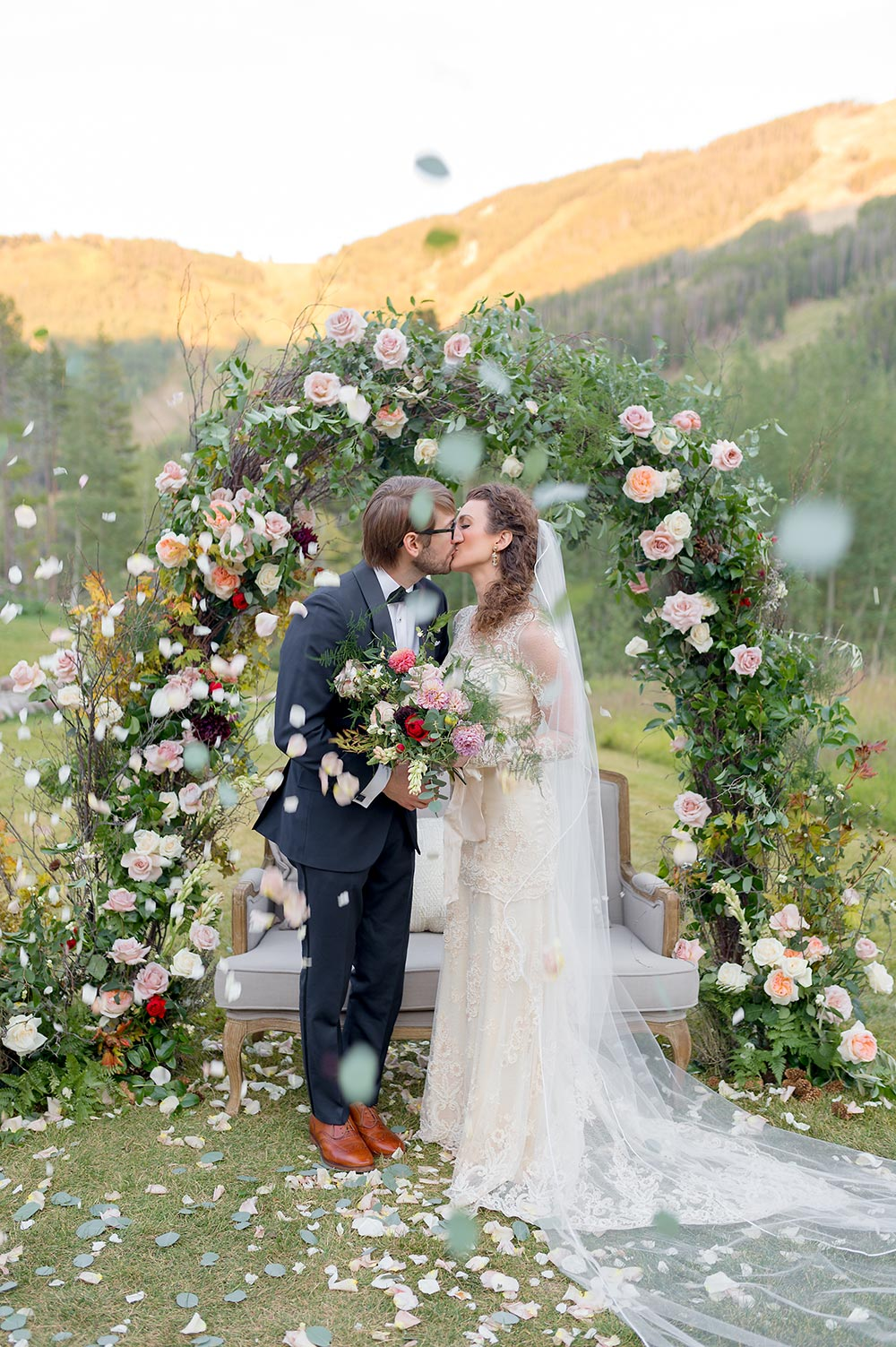 spring pastel floral arbor mountain wedding ceremony