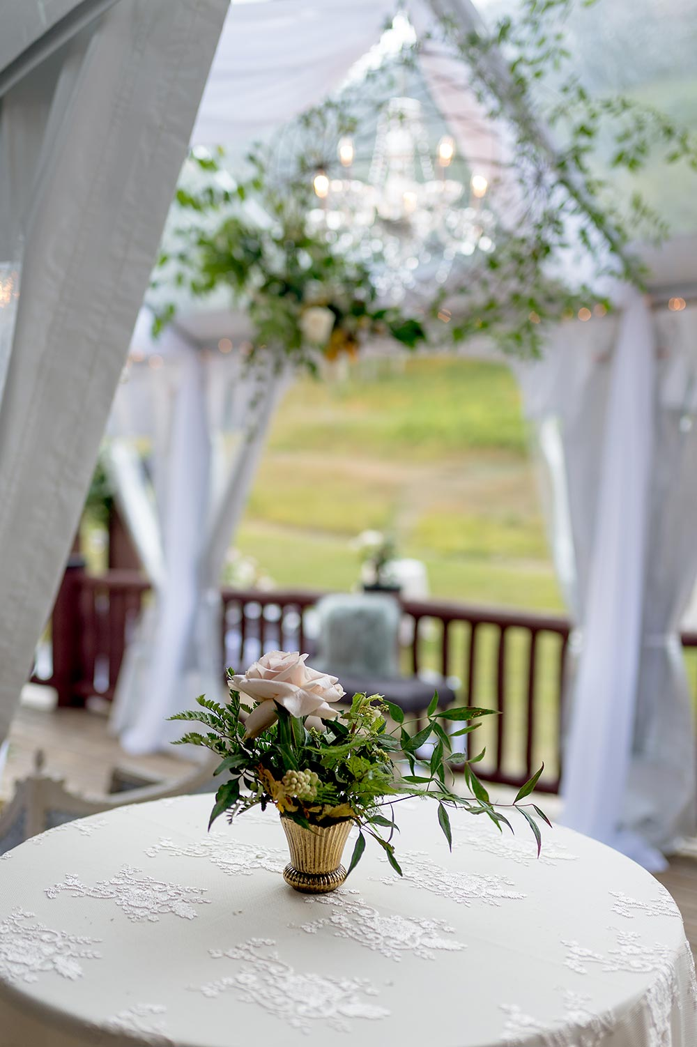 angel vine chandelier and simple wedding centerpiece cocktail hour