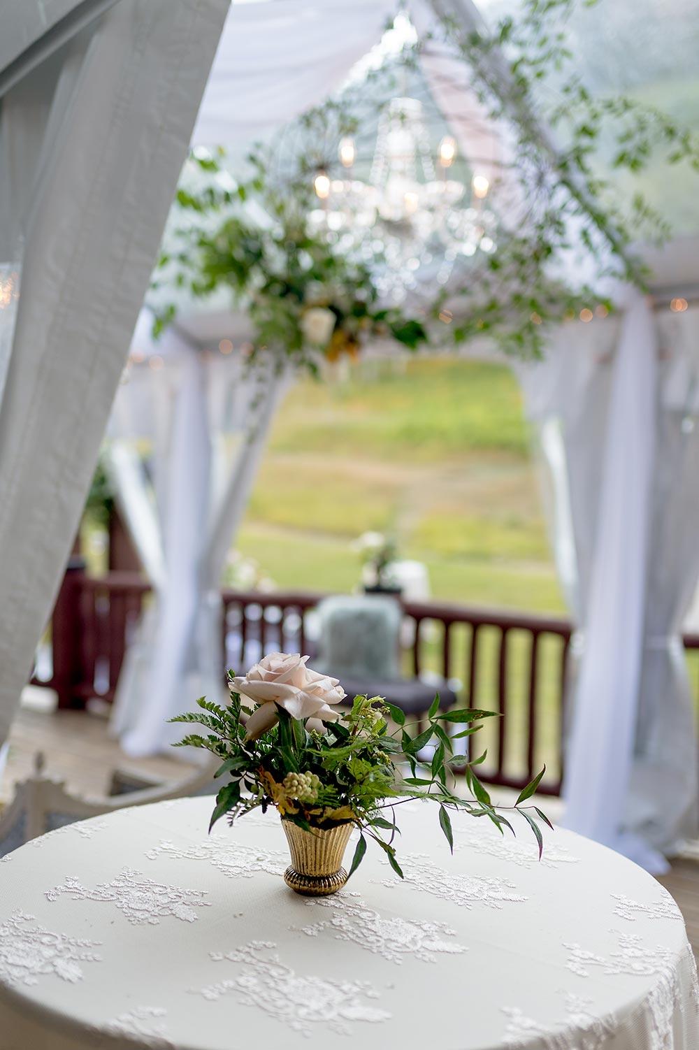 angel vine chandelier and simple wedding centerpiece cocktail hour