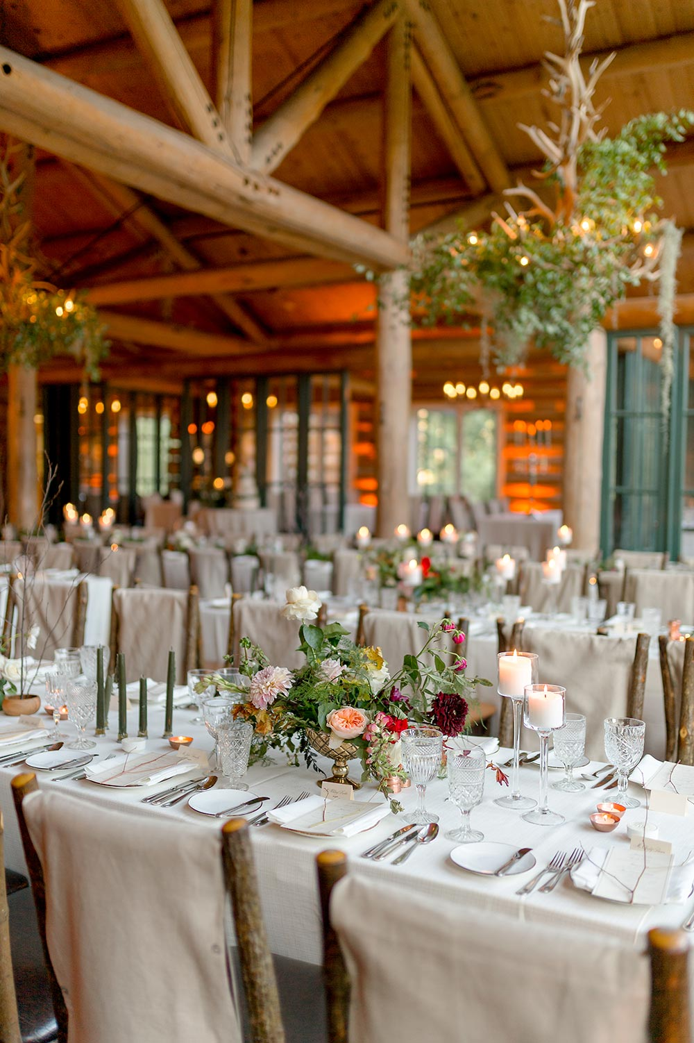 cabin wedding reception with candlelight and angel vines