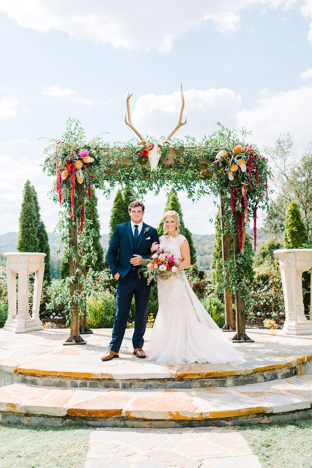 boho bride and groom - photo by Cathrine Taylor Photography https://ruffledblog.com/colorful-alabama-wedding-with-desert-accents