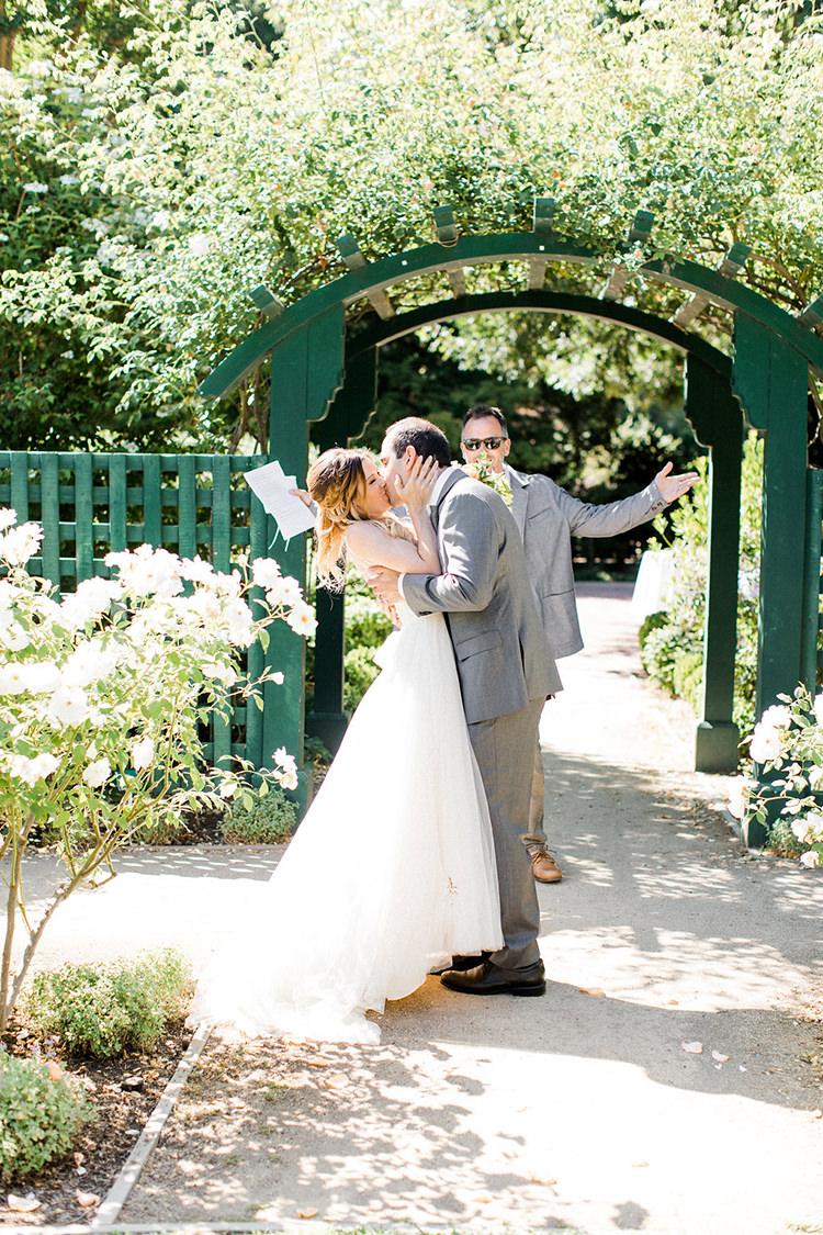 ceremony kiss - photo by Erin Milnik https://ruffledblog.com/colorful-monday-afternoon-garden-elopement