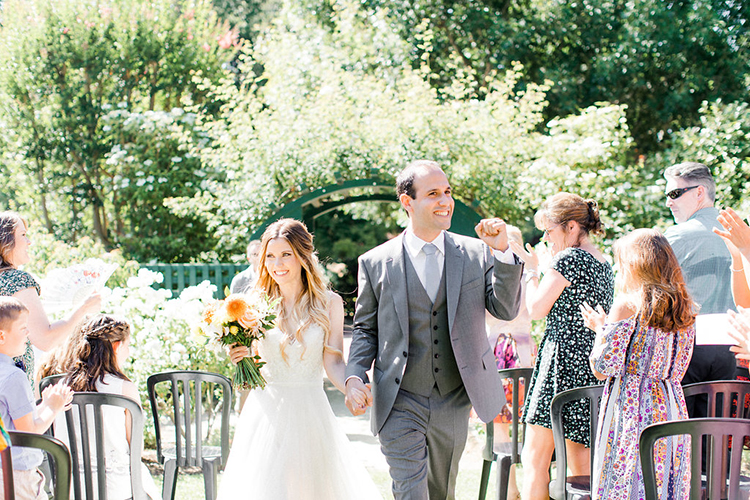 ceremony recessionals - photo by Erin Milnik http://ruffledblog.com/colorful-monday-afternoon-garden-elopement
