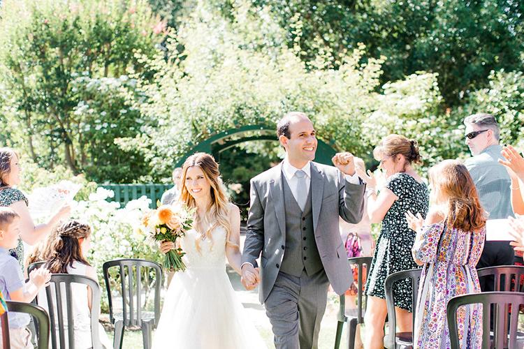 ceremony recessionals - photo by Erin Milnik https://ruffledblog.com/colorful-monday-afternoon-garden-elopement