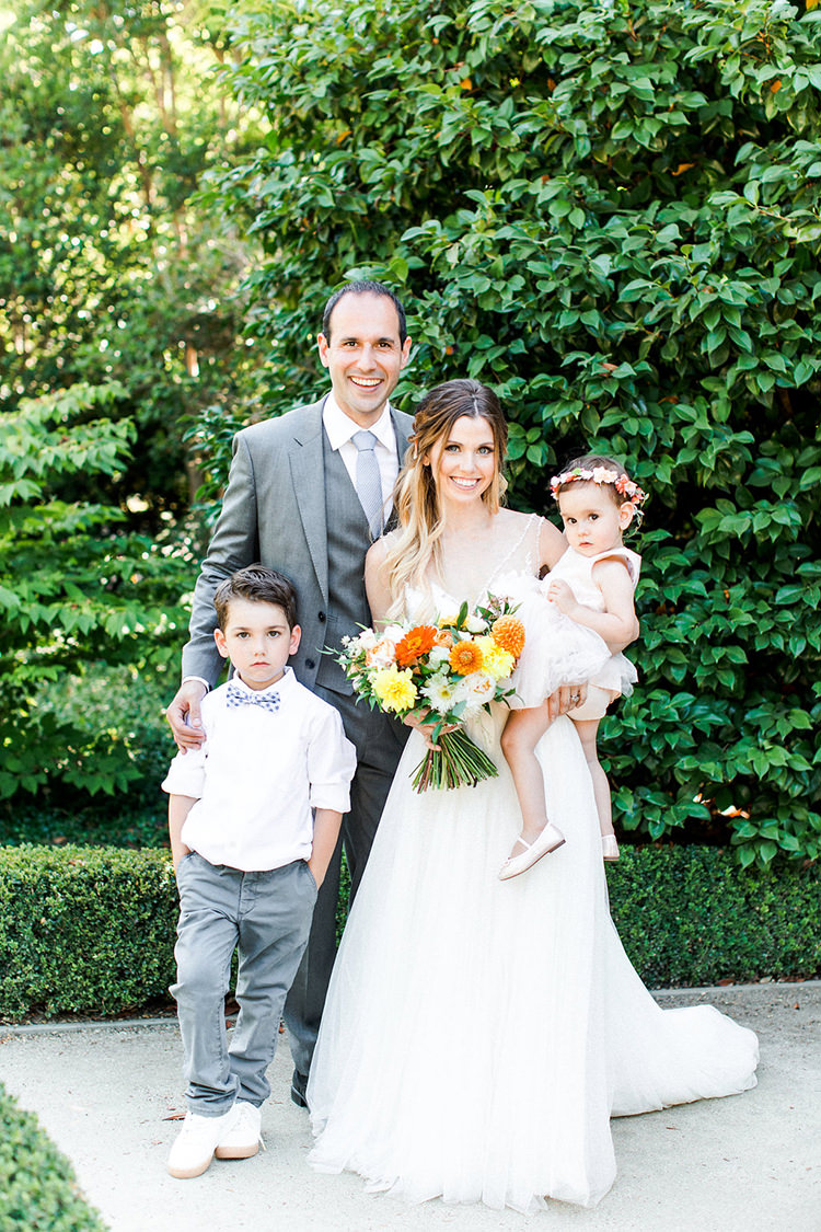 wedding families - photo by Erin Milnik https://ruffledblog.com/colorful-monday-afternoon-garden-elopement