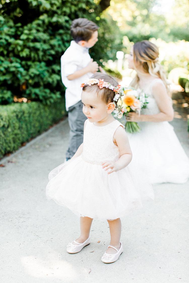 flower girl style - photo by Erin Milnik https://ruffledblog.com/colorful-monday-afternoon-garden-elopement