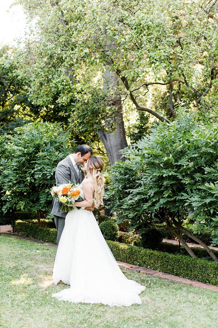 wedding portraits - photo by Erin Milnik https://ruffledblog.com/colorful-monday-afternoon-garden-elopement