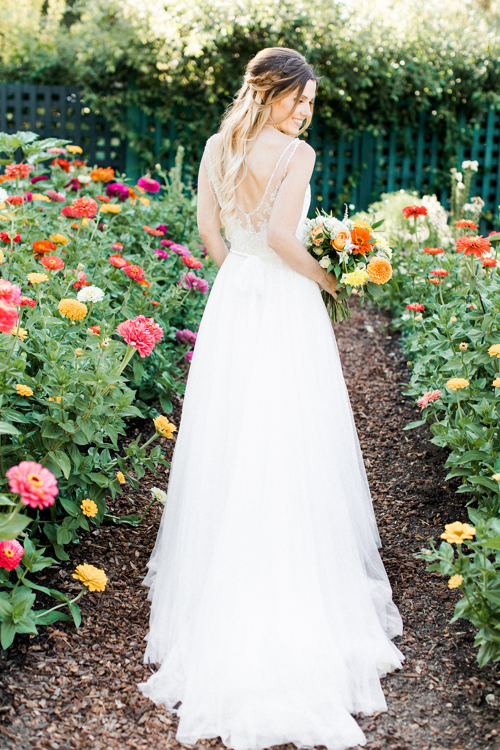 spring wedding dresses - photo by Erin Milnik http://ruffledblog.com/colorful-monday-afternoon-garden-elopement