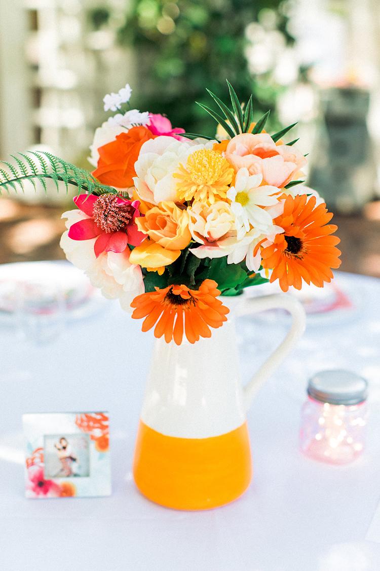 colorful orange centerpieces - photo by Erin Milnik https://ruffledblog.com/colorful-monday-afternoon-garden-elopement