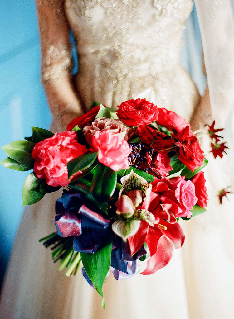 bright red wedding bouquets - photo by Lisa Blume Photography https://ruffledblog.com/runway-to-table-wedding-inspiration-with-bows