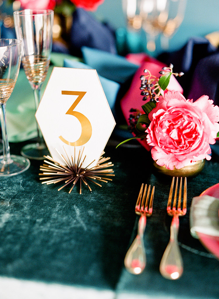 modern wedding table numbers - photo by Lisa Blume Photography http://ruffledblog.com/runway-to-table-wedding-inspiration-with-bows