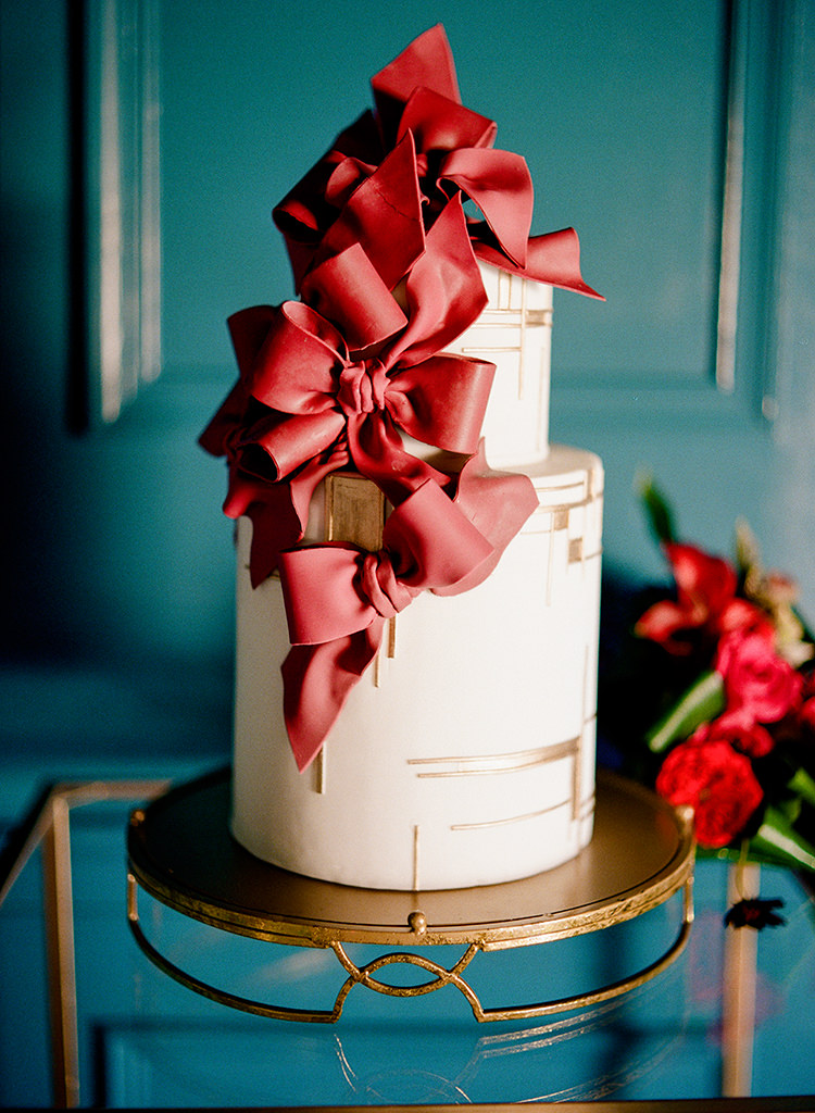 wedding cakes with red accents - photo by Lisa Blume Photography http://ruffledblog.com/runway-to-table-wedding-inspiration-with-bows